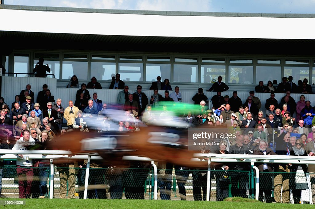 Spectators watch the racing during racing at Huntingdon race course on May 22, 2013 in Huntingdon, England.