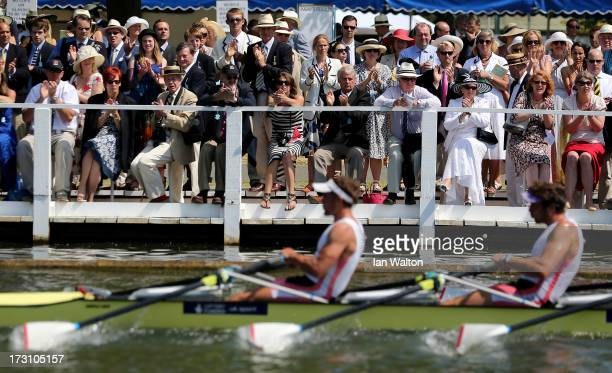 Spectators watch the racing on finals day of the Henley Royal Regatta on July 7 2013 in HenleyonThames England