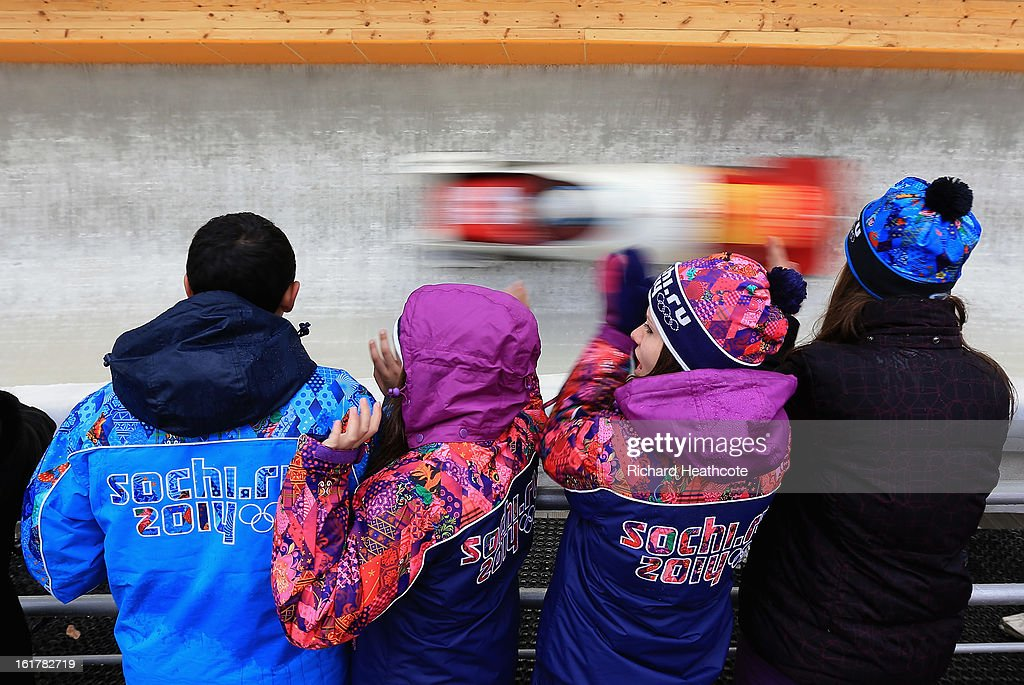 Spectators watch the sleds in action during the Viessman FIBT Bob & Skeleton World Cup at the Sanki Sliding Center in Krasnya Polyana on February 16, 2013 in Sochi, Russia. Sochi is preparing for the 2014 Winter Olympics with test events across the venues.