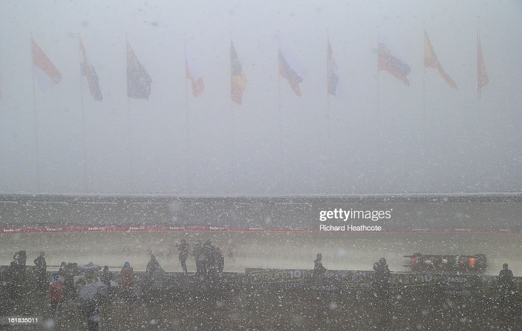 Spectators watch the sleds through the bottom curve in the snow and fog during the 4 man Bobsleigh Viessman FIBT Bob & Skeleton World Cup at the Sanki Sliding Center in Krasnya Polyana on February 17, 2013 in Sochi, Russia. Sochi is preparing for the 2014 Winter Olympics with test events across the venues.