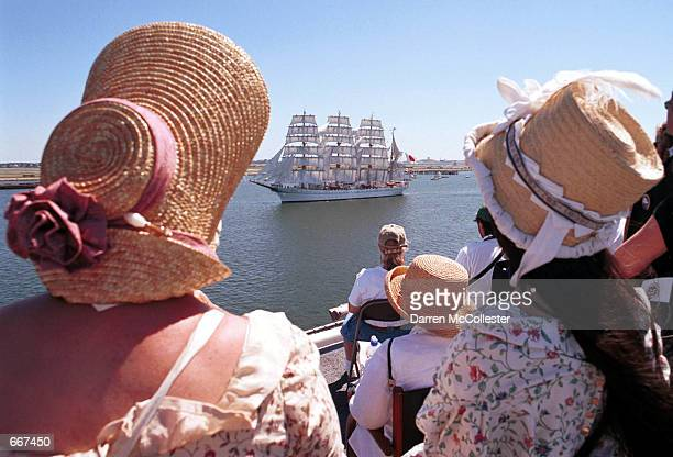 Spectators watch the Tall Ships Grand Parade of Sails from aboard the USS John F Kennedy in Boston Ma July 11 2000 More than 2 million people lined...