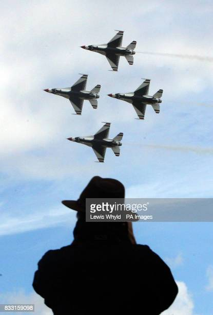 Spectators watch the United States Air Force's aerobatics display team the 'Thunderbirds' made up of F16 Fighting Falcons at the 2007 Royal...