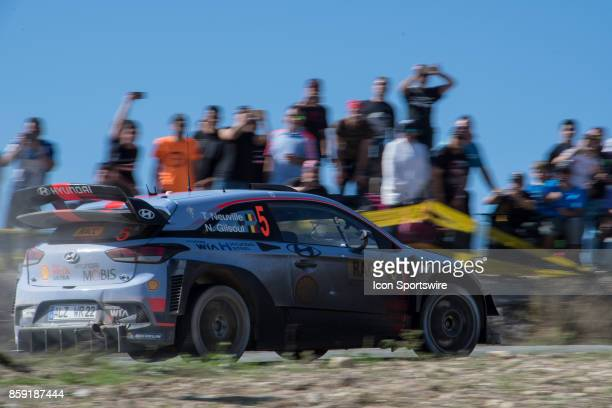 Spectators watch Thierry Neuville and codriver Nicolas Gilsoul of Hyundai Motorsport during second run of the Savalla Stage of the Rally de Espana...