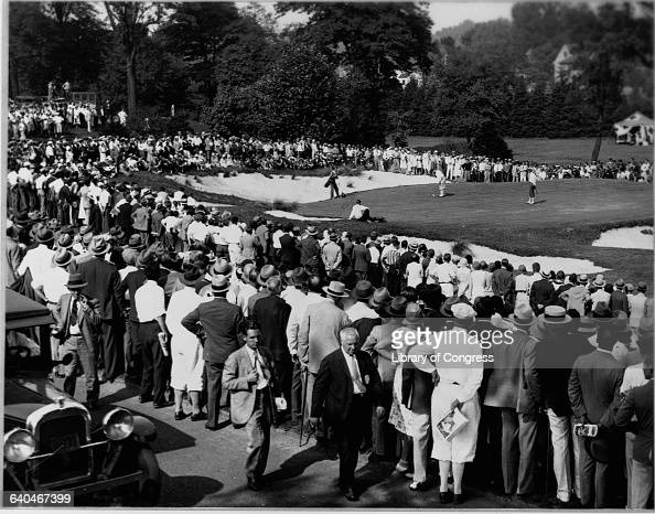 Spectators watching Bobby Jones on the green during the US Amateur Championship golf tournament