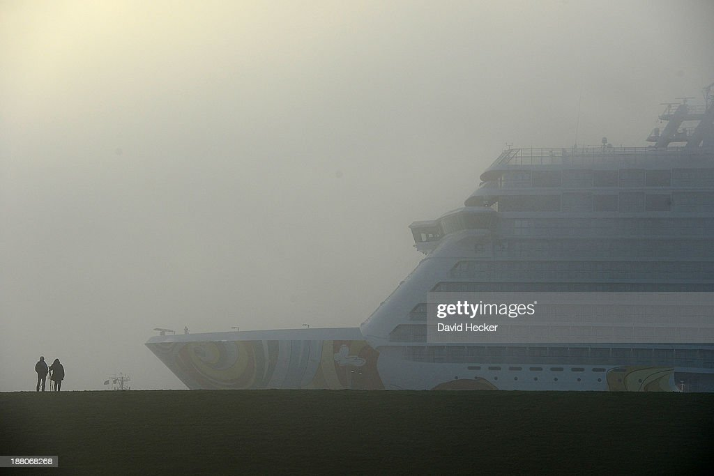 Spectators watching the Norwegian GETAWAY cruise ship on its way down the Ems river towards the North Sea shortly after construction of the ship was...