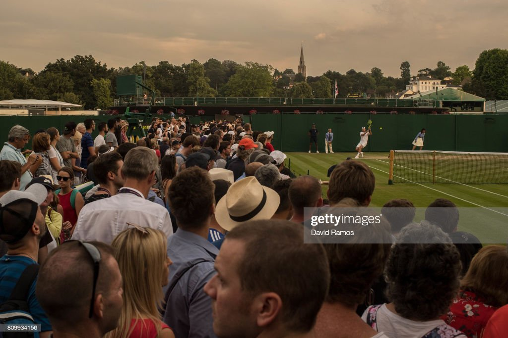 Spectators wathc a match in the outside courts on day four of the Wimbledon Lawn Tennis Championships at the All England Lawn Tennis and Croquet Club on July 6, 2017 in London, England.