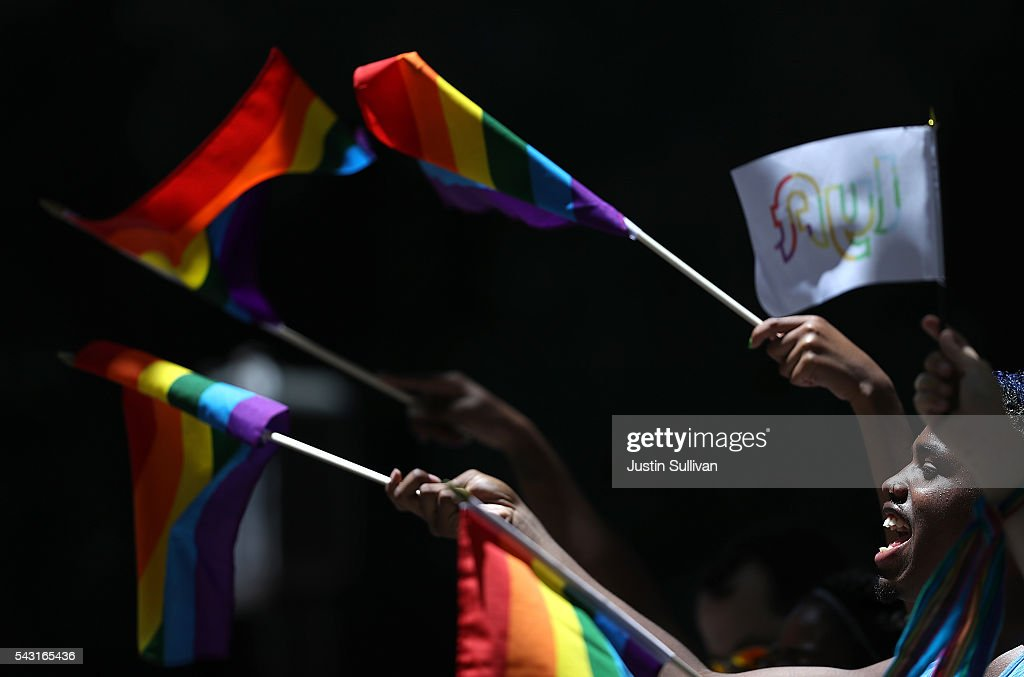 Spectators wave pride flags during the 2016 San Francisco Pride Parade on June 26, 2016 in San Francisco, California. Hundreds of thousands of people came out to watch the annual San Francisco Pride parade, one of the largest in the world.