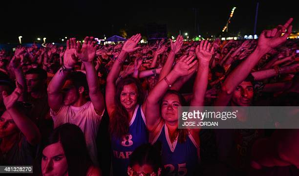Spectators wave their arms as they attend a concert during the last day of the Benicassim International Festival in Benicassim on July 19 2015 AFP...