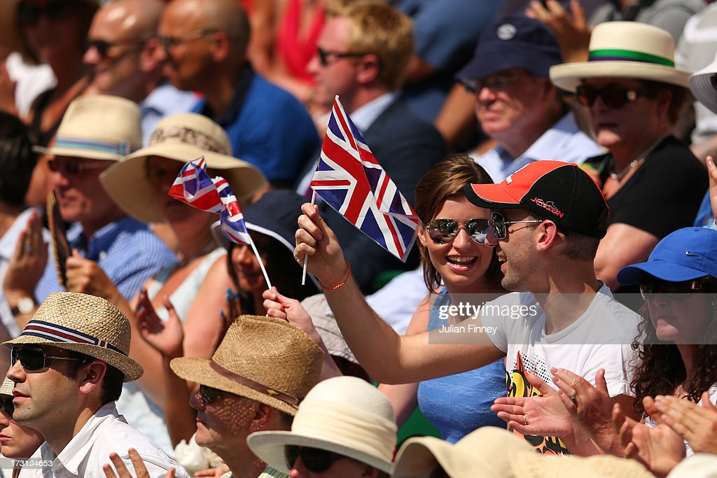 Spectators wave Union Jack flags on Centre Court during the Gentlemen's Singles Final match between Andy Murray of Great Britain and Novak Djokovic of Serbia on day thirteen of the Wimbledon Lawn Tennis Championships at the All England Lawn Tennis and Croquet Club on July 7, 2013 in London, England.