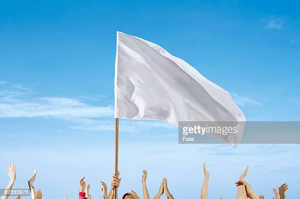 Spectators Waving a White Flag at a Sporting Event