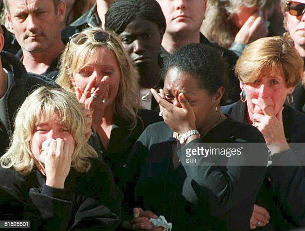Spectators weep in the crowd along London's Whitehall 06 September during funeral ceremonies for Diana Princess of Wales