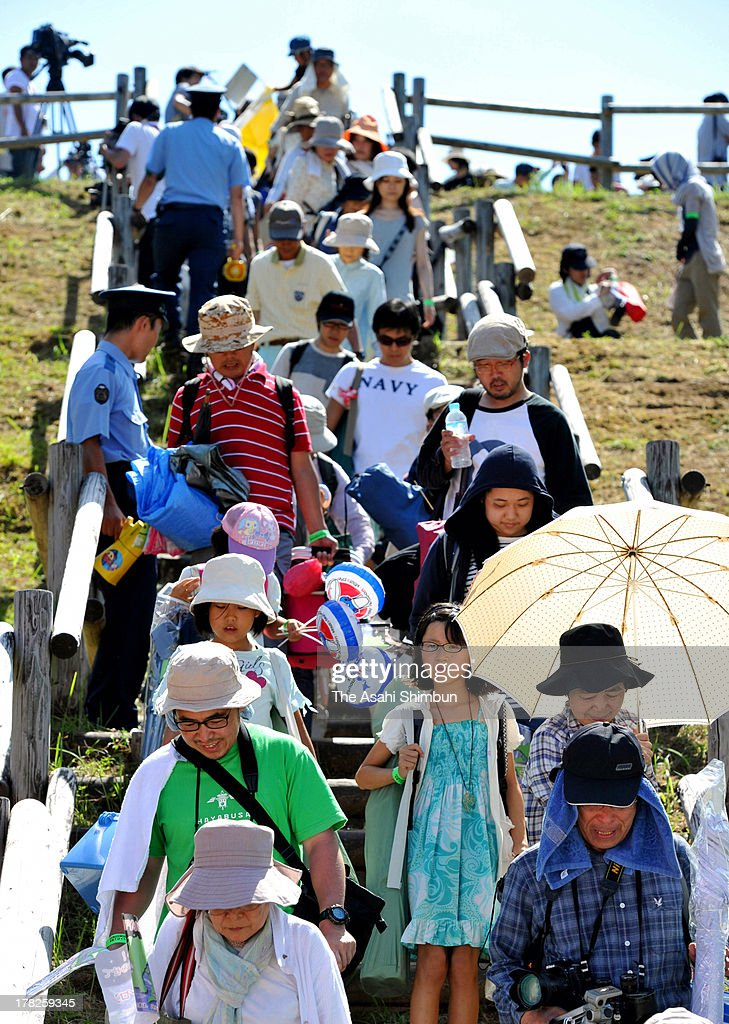 Spectators who expected the Japan Aerospace Exploration Agency (JAXA)'s Epsilon Vehicle (Epsilon-1) launch leave the observation site on August 27, 2013 in Kimotsuki, Kagoshima, Japan. JAXA postponed 19 seconds before the launch, let down 10,000 suectators. JAXA is planning to relaunch after detecting the cause of the irregularity.