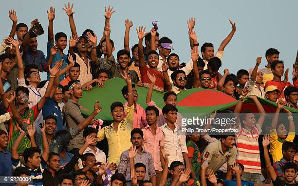 Spectators with a large flag during the third day of the second test match between Bangladesh and England at Shere Bangla National Stadium on October...
