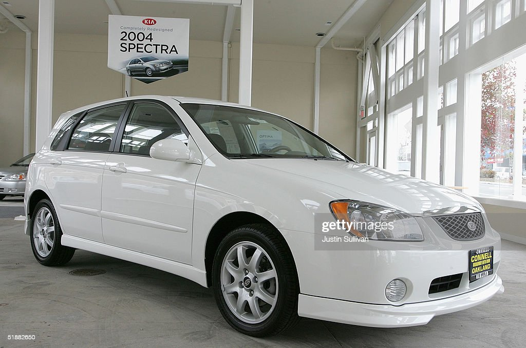 Spectra is seen on display at a KIA Dealership December 20 2004 in Oakland California The Kia Spectra a small fourdoor sedan that starts at $13...