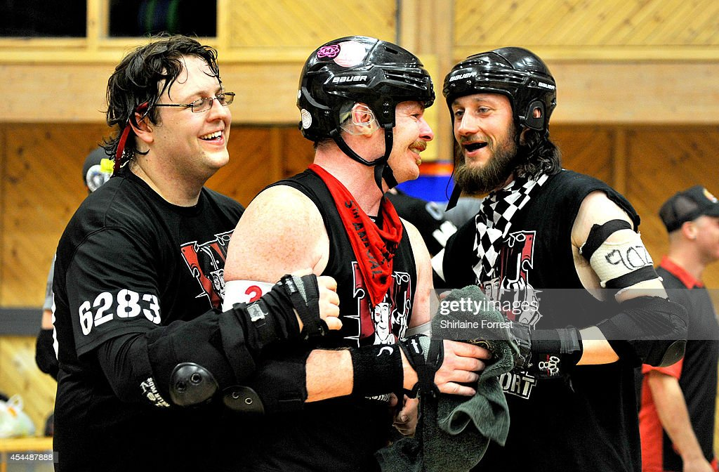 Spectral Aberwraytion, Sutton Impact and Herbie Licious of Southern Discomfort celebrate winning the Men's European Cup roller derby tournament at Walker Activity Dome on August 31, 2014 in Newcastle upon Tyne, England.