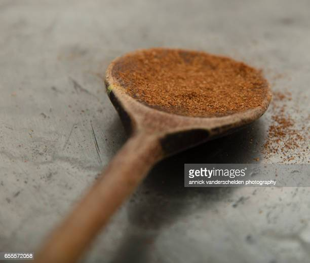 Speculaas powder in wooden spoon.