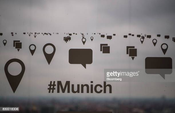 Speech and location icons and the word '#Munich' sit on a window inside the International Business Machines Corp Watson cognitive computing platform...
