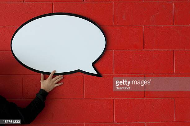 Sprechblase auf Rote Wand