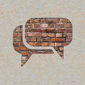 Speech Bubble Icon on the Brick and Plastered Wall.