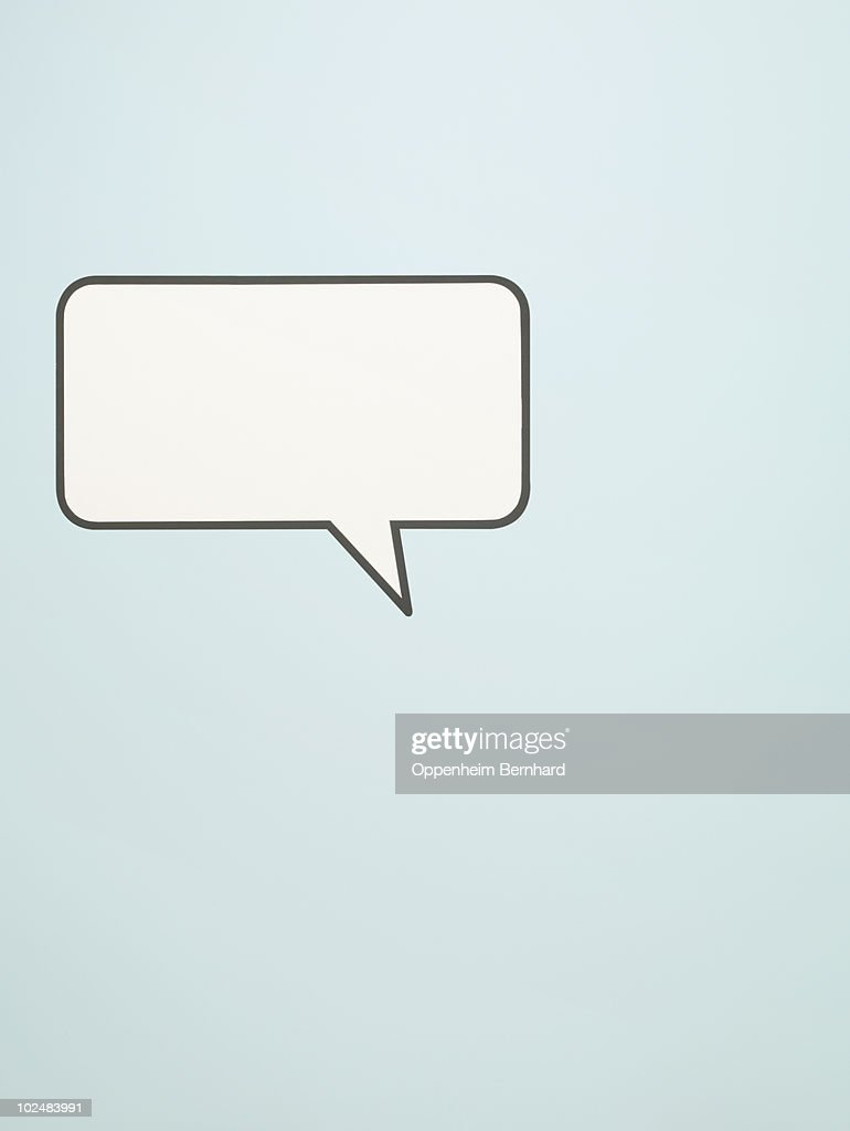 speech bubble on blue background : Stock Photo