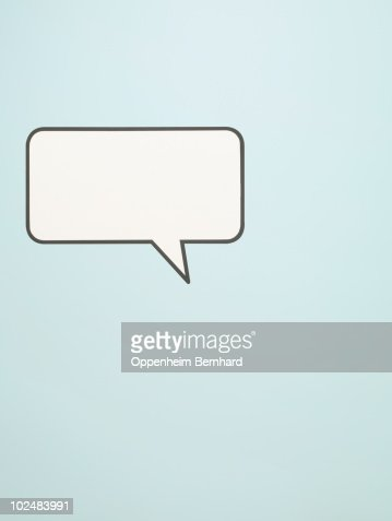 speech bubble on blue background : Foto de stock
