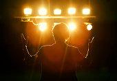 Female politician speaks to audiences under spotlights