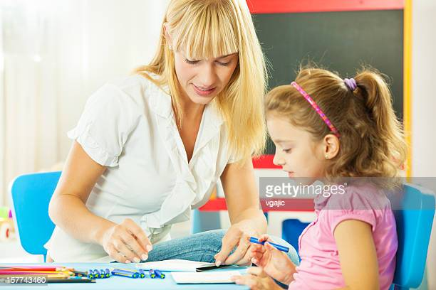Speech Therapist Interacting with child
