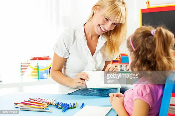 Speech Therapist Talking with child.