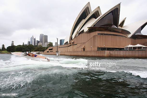A speed boat does a tight corner in front of the Sydney Opera House as Roger Federer plays 'speed boat tennis' on Sydney Harbour with Lleyton Hewitt...
