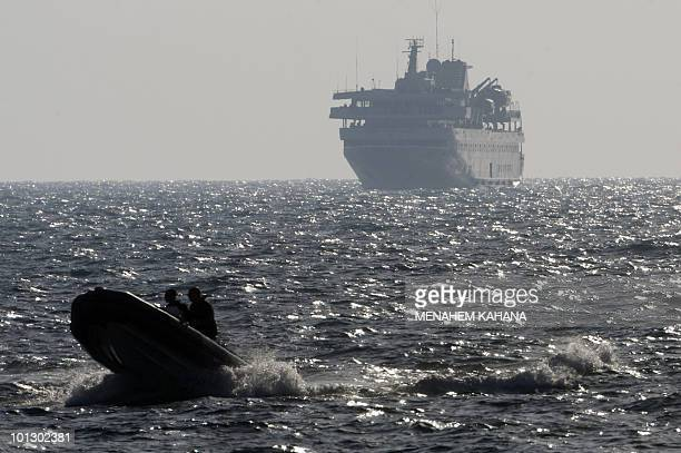 A speed boat escorts Turkish ship Mavi Marmara with Israeli troops on board near the southern port of Ashdod on May 31 after the Israeli navy raided...