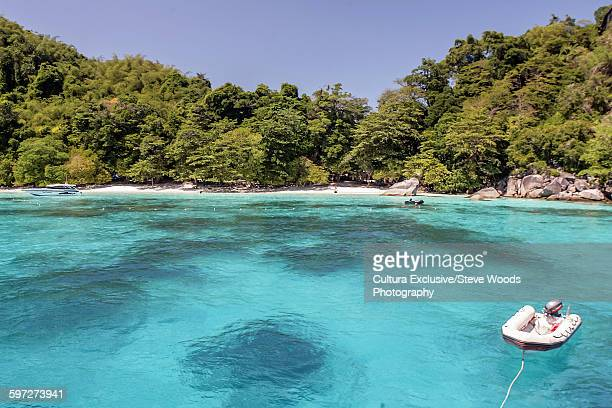 Speed boat tied up on the island of Koh Miang in the Similan islands in the Andaman sea of western Thailand