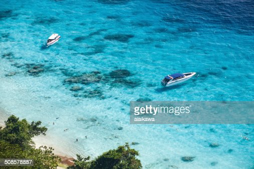 Speed boats in crystal clear tropical sea : Stock Photo