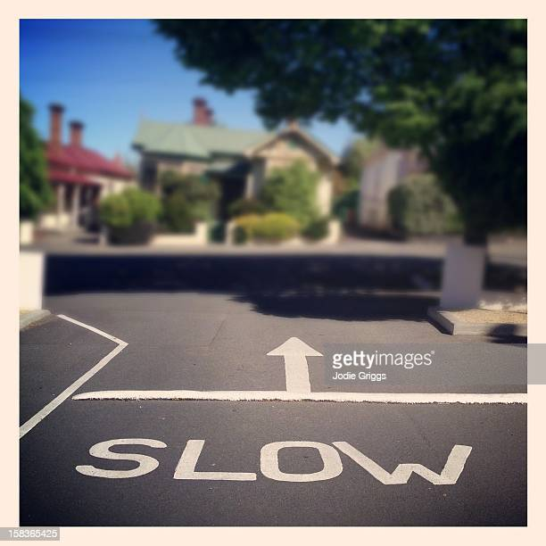 Speed Bump on road with 'slow' written before it