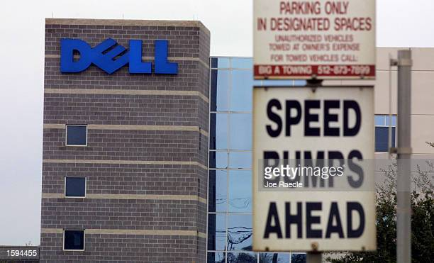 A speed bump sign stands in front of the Dell Computer Corp February 15 2001 in Round Rock Texas Dell announced today that it is cutting 1700 jobs in...