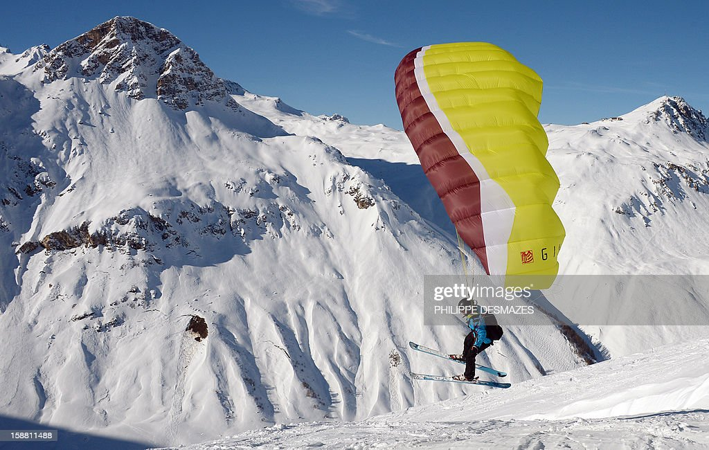 A speed rider flies over a snowy slope on December 29, 2012, in the French Alps resort of Val d'Isere. The speed riding is an open-air sport associating the ski, the paragliding and the parachuting, and which consists in going down the snowy slopes equipped with a pair of skis and with a sail of low surface, by alternating the glide and the flight. AFP PHOTO PHILIPPE DESMAZES
