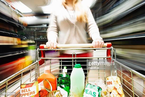 Speed shopping! Racing through supermarket creates extreme motion blur