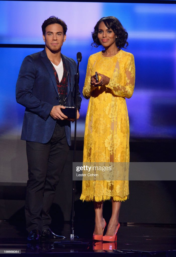 Speed skater Apolo Anton Ohno (L) and actress Kerry Washington onstage during the 40th Anniversary American Music Awards held at Nokia Theatre L.A. Live on November 18, 2012 in Los Angeles, California.