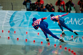US speed skater David Cruikshank and Russian skater Aleksandr Golubev compete in the men's 500m final at MWave during the 1998 Winter Olympic games