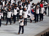 Speed skater Kyou Hyuk Lee of the South Korea Olympic team carries his country's flag during the Opening Ceremony of the Sochi 2014 Winter Olympics...