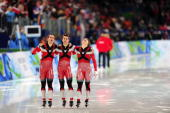 2010 Winter Olympic Canada Mathieu Giroux Lucas Makowsky and Denny Morrison victorious after winning Men's Team Pursuit Final gold at Richmond...