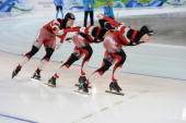 2010 Winter Olympic Canada Mathieu Giroux Lucas Makowsky and Denny Morrison in action during Men's Team Pursuit Final at Richmond Olympic Oval...