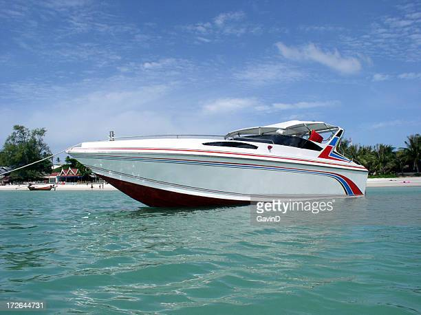 Speedboat anchored near beach in Thailand
