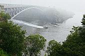 Speedboat and bridge