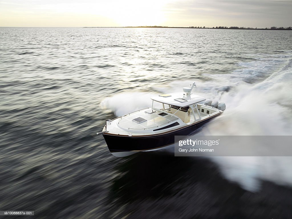 Speedboat at sunset, blurred motion