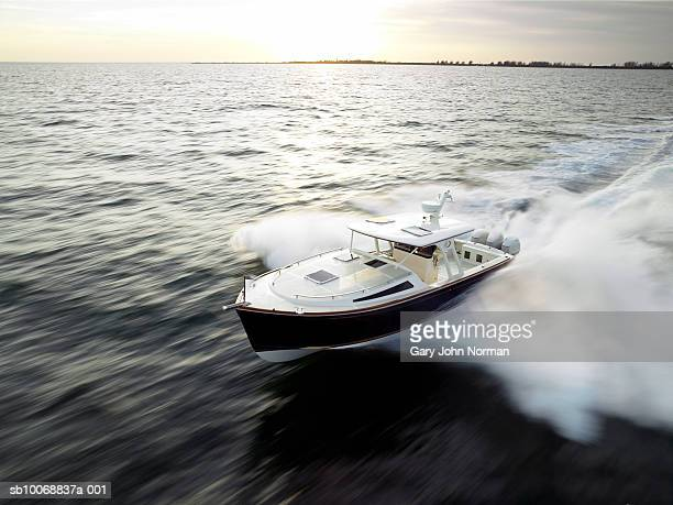 Speedboat at sunset, blurred motion