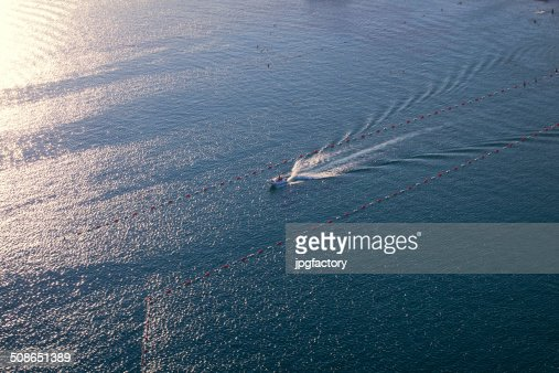 speedboat in action at sunset : Stock Photo
