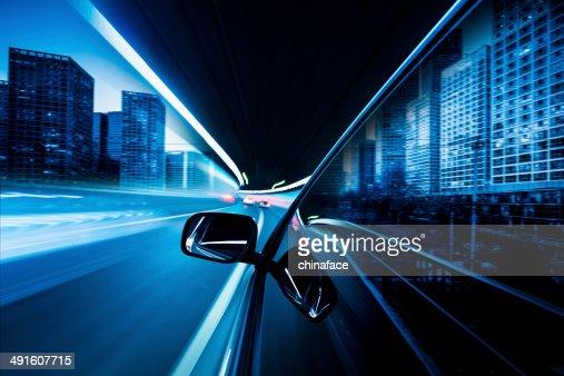 speeding car in night at street