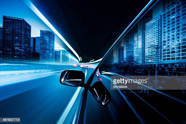 speeding car in night at street