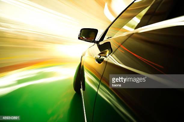 A speeding car with blurred lights