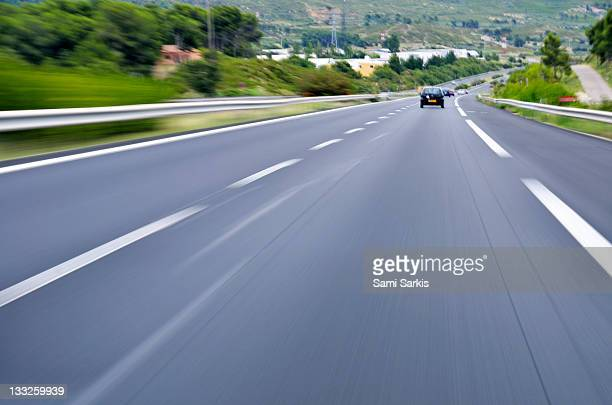 Speeding cars on A6 highway, Provence, France